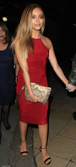 Tulisa Contostavlos is flanked by two HUGE bodyguards after.