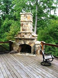 outdoor fireplace on deck stone stacked massive corner fireplace on wooden deck outdoor outdoor deck fireplaces