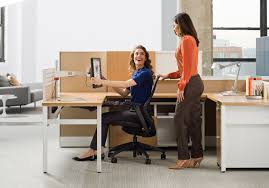height workstations lower panels let in natural light and encourage employees to work as a team new storage solutions include a personal coat closet