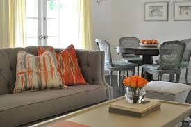 gray sofa with orange pillows