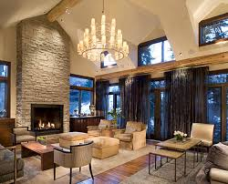 interior white living room wall with stone high fireplace and high glass windows with black
