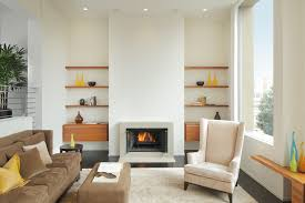modern built in wall shelves with fireplace suede upholstery sofa on white rug under recessed lights