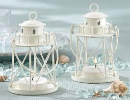 as a beautiful beach themed wedding favor this lighthouse tea light holder shines great fot tabletop lighting too beach theme lighting