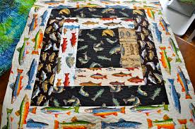 LuAnn Kessi: Gone Fishing......Baby Quilt & It is all quilted, trimmed and ready for a binding. Adamdwight.com