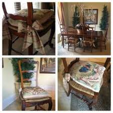 needlepoint cushions with tie backs roxanne ladder back chairs rush seating