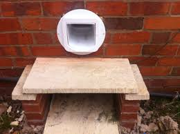exterior of cat flap tunnel through wall