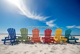 adirondack chairs on beach. Perfect Chairs A Row Of Colorful Adirondack Lounge Chairs Lined Up On The Beach Under A  Blue Sky Inside Chairs On Beach C