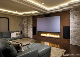 home theater ceiling lighting. this home theater design includes rope lighting in the ceiling and a large contemporary fireplace placed w