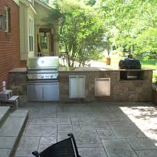 outdoor kitchen design with built in grill smoker trash drawer and storage