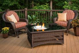 naples fire pit table on a wooden deck