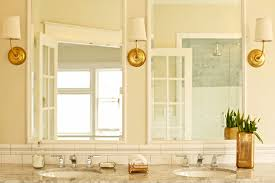 brass bathroom light. Brass Bathroom Lighting Hanging On Wall Over The Two Mirror With Sinks And Faucets Underneath Decorated A Small Flower Vase Made Of Light