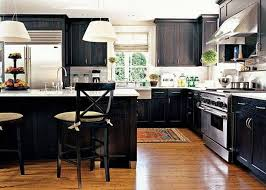 best black kitchen cabinets with white shade pendant lights and stool decors