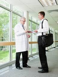 Pharmaceutical Representative Doctor Talking Talking With Pharmaceutical Representative In