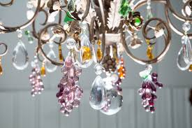 louis xv style 12 light iron chandelier with colored fruit shaped crystals