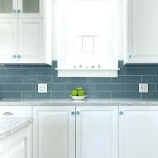mastic tile backsplash glass mosaic white cabinets with blue glass knobs installing glass mosaic tile mastic