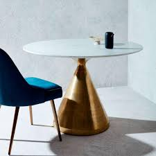 round dining table with marble top and brass base from westelm
