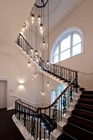 view in gallery plain glass pendant lighting hanging over a staircase