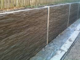 natural dark brown cement block wall that seems so and brings great nuance of the house design it also has a simple construction retaining cons