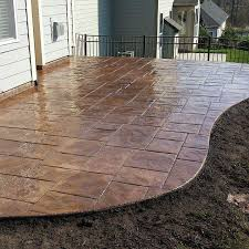 garrett construction proudly installs custom colored and stamped decorative concrete patios sidewalks and walkways driveways and driveway accents