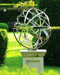 outdoor armillary sphere traditional sundial in a contemporary garden