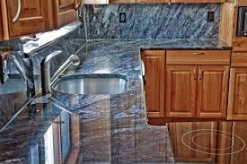 elegant kitchen photo in dc metro with blue countertops