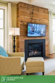 rustic meets modern with the chicago design s wood covered fireplace the warm wood
