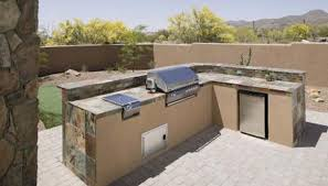 an outdoor kitchen adds convenience to outdoor spaces