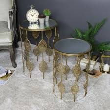 pair of gold mirrored side tables