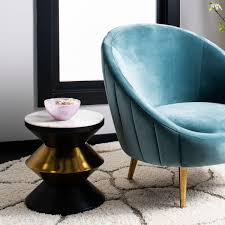 side table is a modern heirloom its smooth white top is paired with three sleek tiers finished in matte black and chic shimmering gold