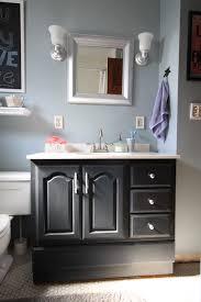 painting vanity black in bathroom. bathroom vanity makeover with chalk paint painting black in a