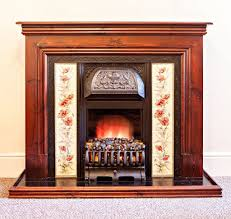 victorian style fireplace with wooden mantelpiece tiled surround