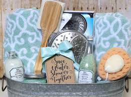 the gift basket also includes big fluffy bath towels hand towels they re stuffed down in the bottom to prop up the smaller items a back scrubber shower
