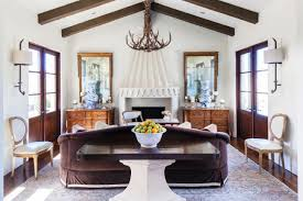 modern fascinating modern cabin with wood beam ceiling also antler chandelier and pedestal table