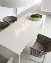 sunset table designed by francesco rota for paola lenti
