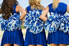 cheerleaders holding pom-poms rear view (mid section) (close-up) Cheerleaders (close-up