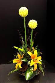 alliums and lilies contemporary design  Silk Floral  ArrangementsContemporary DesignArtificial FlowersCentrepiecesIkebanaFloral  DesignsYellow ...