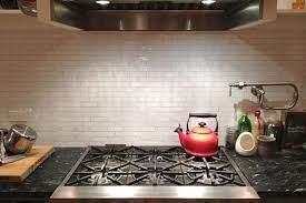 to clean greasy backsplash behind stove