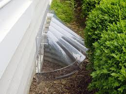 a sunhouse window well with a domed plastic