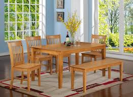 oak finish six piece bench style dining room set with large rectangle table it s