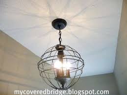 hanging orb light orb chandelier from 2 hanging planter baskets from 5 each made hanging glass orb light outdoor hanging orb lights