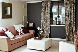 living room with chocolate brown walls. decoration paint and accent wall ideas to transform your room. living room white sofas with brown wooden flooring lower coffe table in dark chocolate walls a