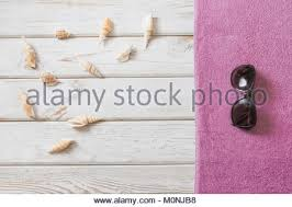 blank white beach towel. Beach Towels · Beach Towel And Summer Accessories On White Wooden  Background. Travel Concept. View From Above Blank