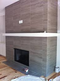 12x24 porcelain tile on fireplace wall and return walls, floor to ceiling.