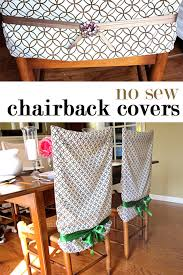 two dining room wood chairs with chair back covers made using pillowcases