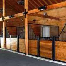 low horse stall fronts for socialization heavy wood posts and wood in the stalls for a rich look lucas equine love these stall designs