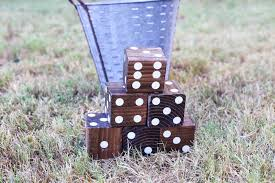 looking for easy ways to get your family to spend more time outside these wooden yard dice are easy to make and perfect for playing yard yahtzee with the