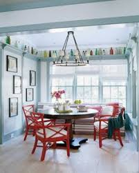 blue kitchen with pops of red via steve gambrel i love the shelf with colored bottles colored dining tablered