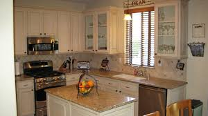 furniture for kitchen cabinets. Old And Rustic Kitchen With Wall Mounted Microwave Under White Color Staining Oak Cabinets Granite Countertop Glass Window Plus Island In Furniture For