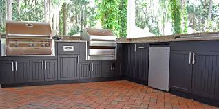 premium polymer outdoor kitchen in black with fire magic e660i and memphis pro built in grills