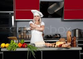 kitchen table with food. Stock Image Of \u0027Young Beautiful Girl Chef In The Kitchen Next To Table With Food